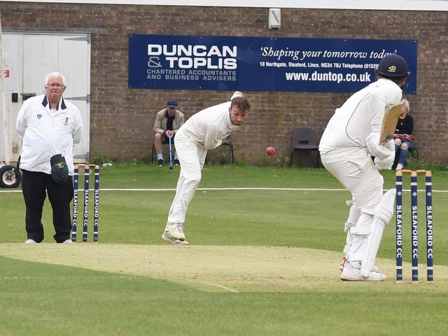 Woodhall Spa's Joe Irving sends down a delivery at Sleaford last year. Photo: David Dawson