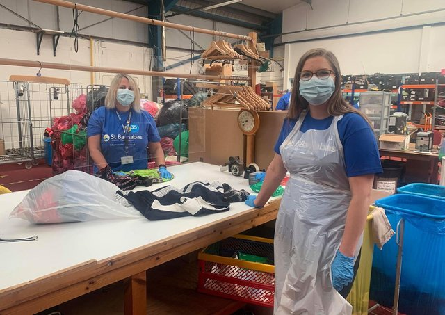 Sorting bags at the St Barnabas Hospice warehouse after the drive-thru donation scheme. EMN-200716-131130001