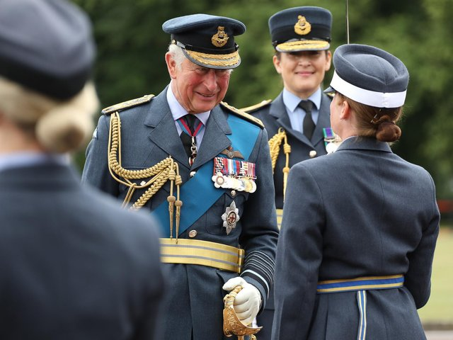 Congratulating a graduate on parade at RAF College Cranwell - Prince Charles as reviewing officer.