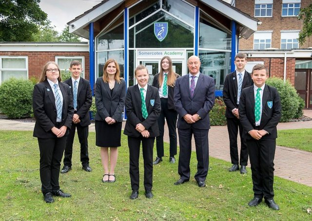 Somercotes Academy Principal Frances Green, alongside CEO of Tollbar Multi Academy Trust David Hampson, and several students. (Picture: Sean Spencer/Hull News & Pictures Ltd.)