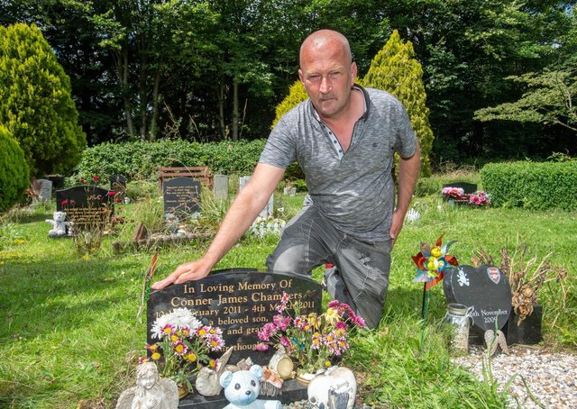 Darren Chambers at his son's grave.