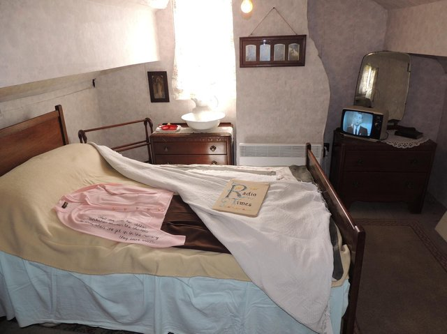 Mrs Smith's bedroom. She used to warm up her clothes with the heat from the bed in the morning.