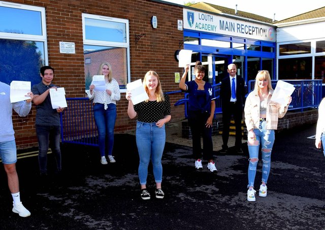 Socially-distanced GCSE students celebrate at Louth Academy today with Martin Brown, Executive Principal. EMN-200820-122718001