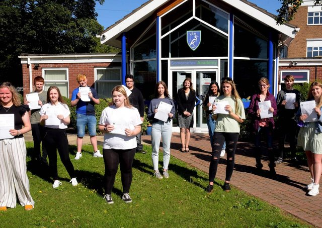 GCSE students celebrate outside Somercotes Academy today with Principal Frances Green. EMN-200820-124425001