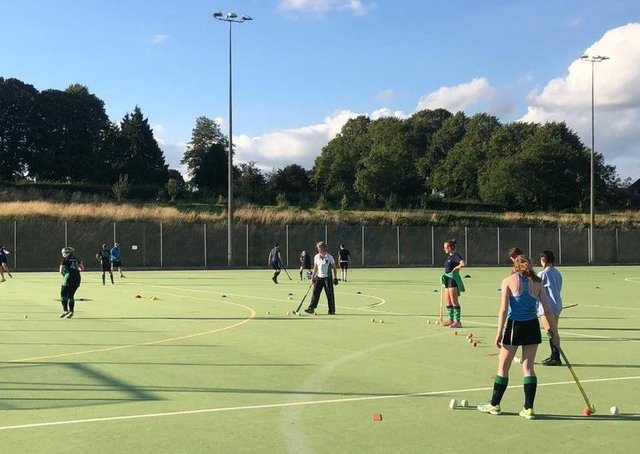 Louth Hockey Club celebrates £5,000 donation towards new artificial pitch.