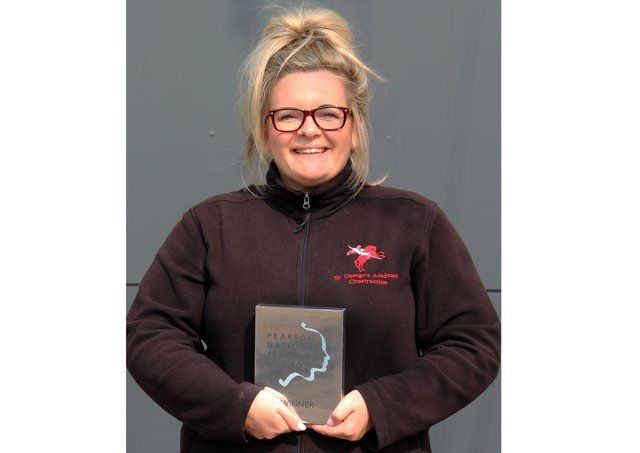 Design and Technology teacher Rebecca Topps of St George's Academy, with her silver award. EMN-200916-194055001