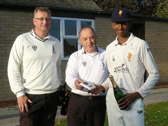 Pothula collects his Man of the Match champagne from umpires Nick Law and Paul Goodhand.