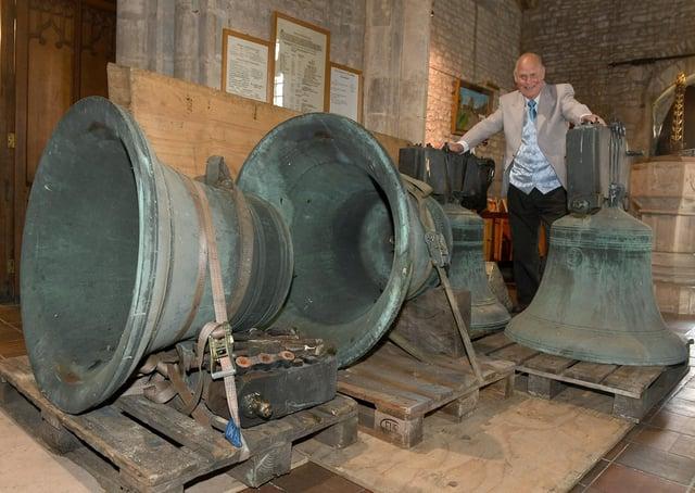 Ruskington church being taken away for repair. Alwyn Kirk with the bells. EMN-200921-170122001