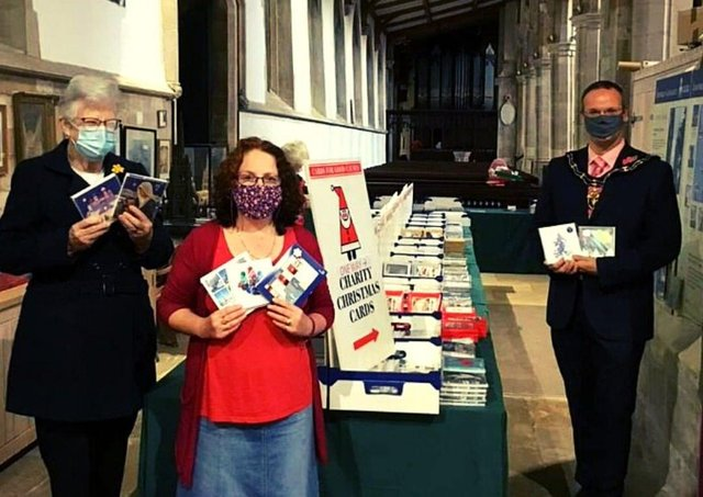 Mayor of Louth, Councillor Darren Hobson, (right) pictured at the Cards for Good Causes pop up shop.