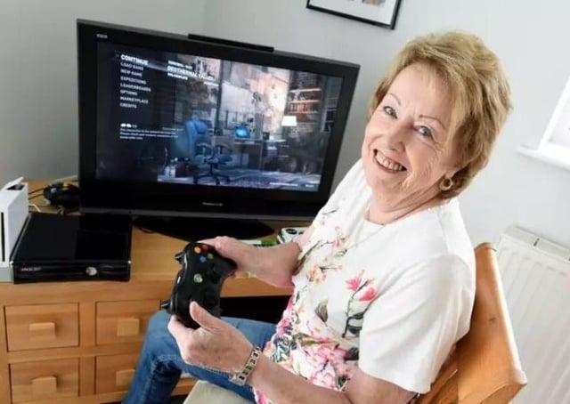 Bridget Odlin, 76, enjoying  one of her many video games.