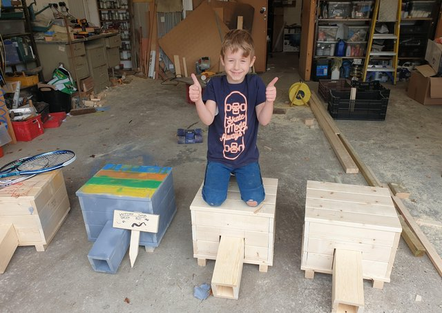 Nathaniel with his hedgehog homes