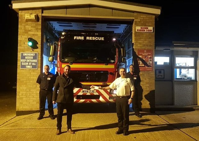 Members of Binbrook fire crew gratefully accepted the donation on behalf of the Firefighters Charity