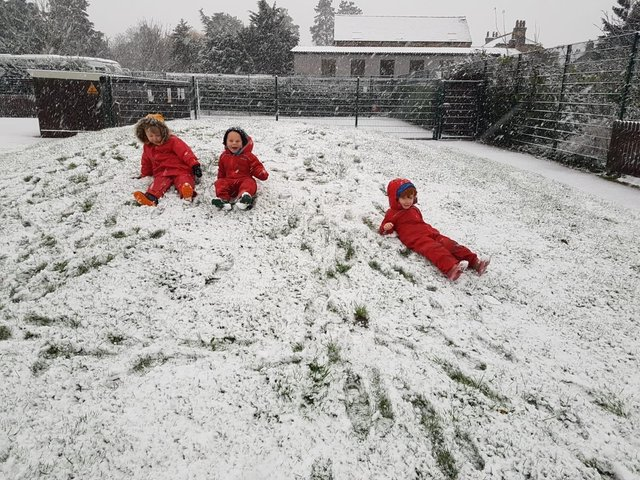 Sliding in the snow at Ruskington Chestnut Street School.
