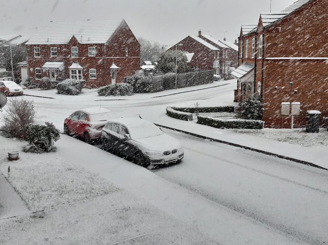 Snow is falling and settling fast on quieter roads and pavements, potentially creating slippery conditions for drivers and pedestrians in Sleaford area.