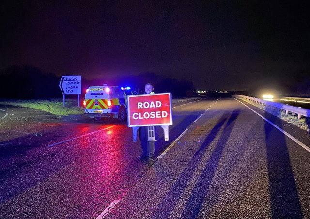 The A17 closed due to flooding overnight around Sleaford. Photo: Lincs Police Specials. EMN-201224-081638001