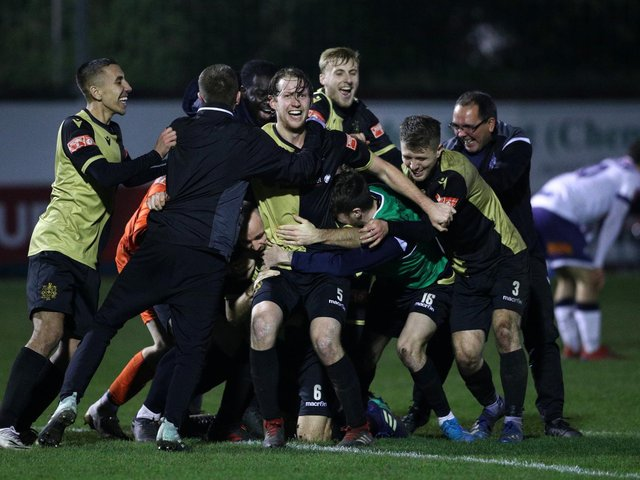 Marine players celebrate winning the match after the final whistle during the Emirates FA Cup Second Round contest against Havant and Waterloovile. Photo: Getty Images