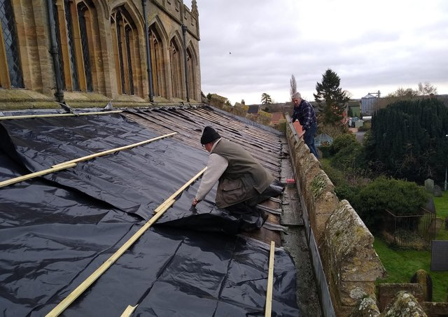 Makeshift repairs being made to the roof of St Andrew's Church, Billingborough after the lead theft. EMN-210601-184744001