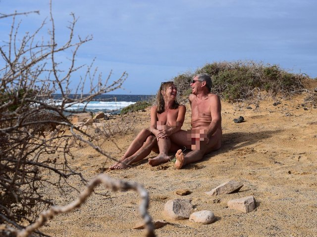 John and Donna relaxing on the beach.