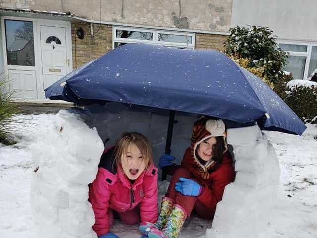 Jessica and Lexi in the finished igloo