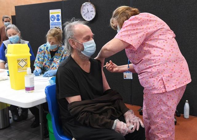 Covid-19 Mass Vaccination Centre at PRSA, Boston. John Lewis of Algarkirk receiving his vaccination EMN-210215-130350005