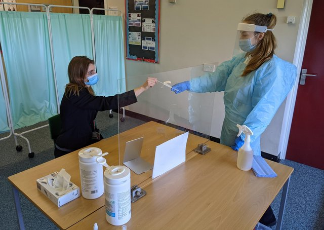 Frances Green, Somercotes Academy Principal, and Testing Assistant Hannah Teagle at one of the Covid-19 testing stations in the county. EMN-210103-134606001
