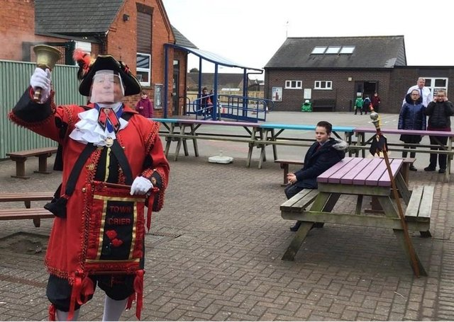 Town Crier David Summers at Sutton on Sea Community Primary School earlier this week.