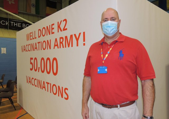 Medical director of the Grantham and Sleaford Primary Care Network of surgeries, Dr Adriaan Van Biljon, celebrates hitting over 50,000 vaccinations in the area two weeks ago. EMN-210322-175358001