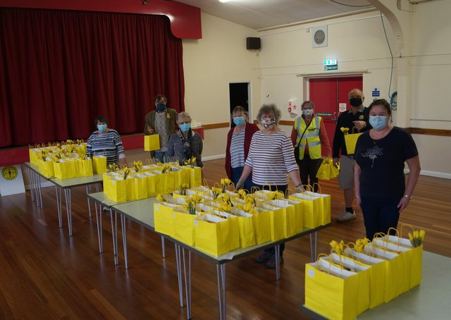 Some of the volunteers who prepared, packed and distributed the Easter goodie bags EMN-210329-151311001