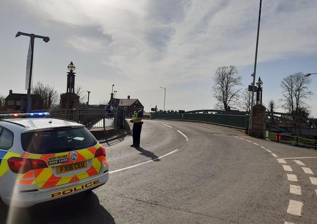 Police on the scene at Sluice Bridge, Boston.