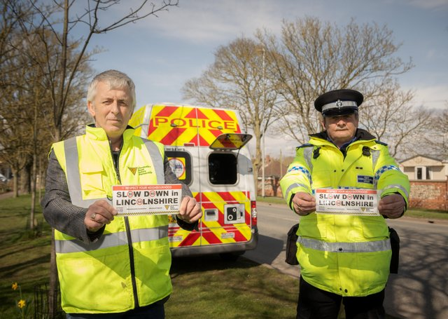 John Siddle from the Lincolnshire Road Safety Partnership and PCSO Dave Bunker with their bumper stickers for the new campaign they want drivers to get behind. EMN-210330-160205001