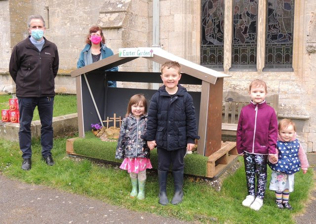 Dropping off painted pebbles at St Botolphs Easter garden, Jake and Mia, Sophie and Phoebe, with Rev Mark Thomson and churchwarden Sally-Anne Caunter. EMN-210504-103434001