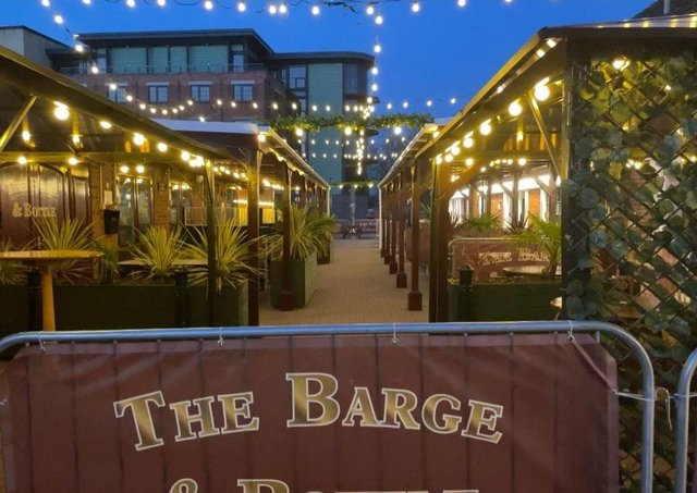 Mick and Donna Wells are proud of their new seating area outside the Barge and Bottle in Sleaford. EMN-210604-172156001