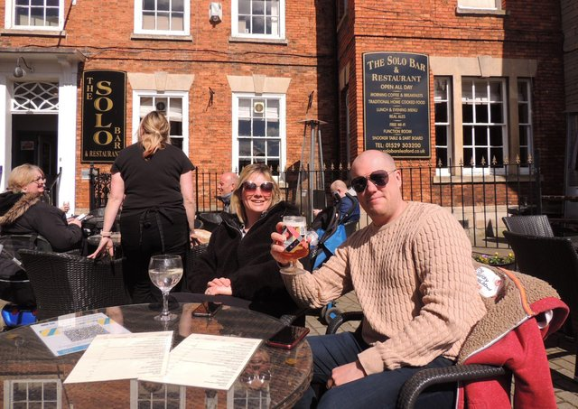 Kyla and Mark Roberts raise a glass at the Solo Bar and Restaurant in Sleaford Market Place. EMN-211204-163439001