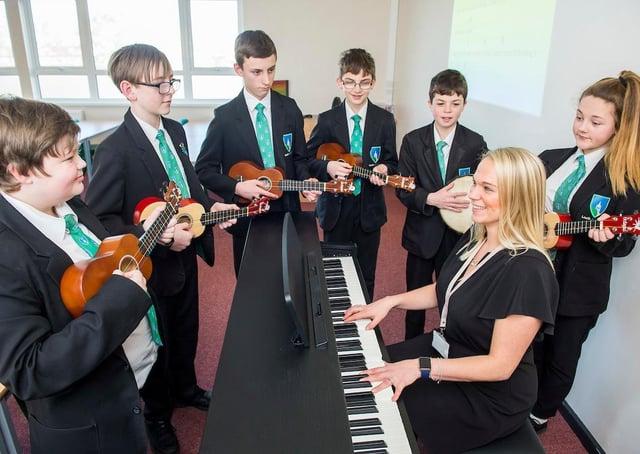 Teacher Samantha Baker with Year Eight pupils Kristian Tolley, Oliver Warne, Cody Atkinson, Sam North, Jamie Atkinson, and Alana Marper.