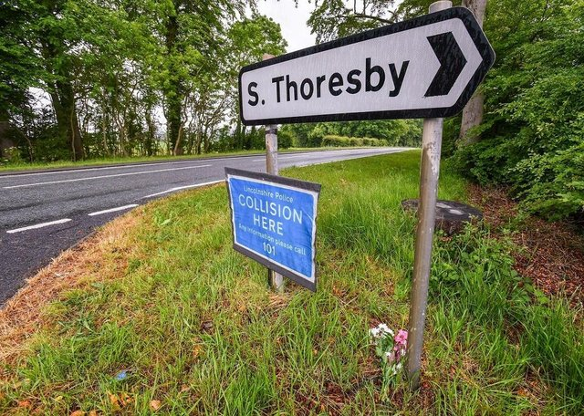 Flowers were left near the police collision sign, on the A16 at Calceby. EMN-201006-155035001