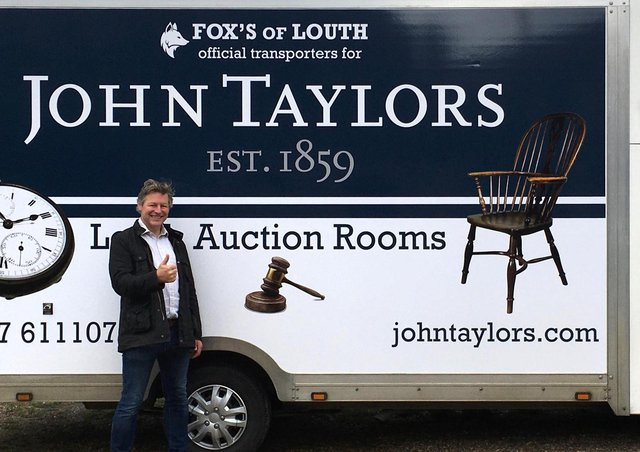 Auctioneer James Laverack with the new auction room transport.