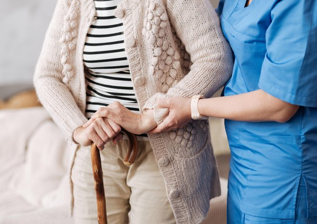 Care - Elderly patient aided by nurse PPP-191219-122759003