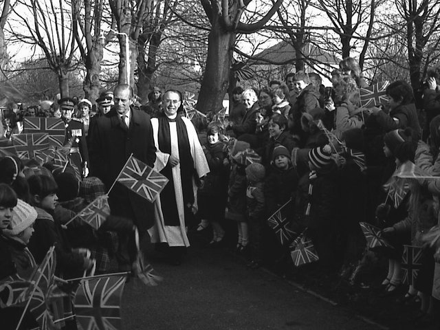 The Duke arrives at St Mary's Church in Mablethorpe, accompanied by Rev D Woods and the Lord Lieutenant of Lincolnshire Capt Henry Neville to be greeted by local schoolchildren. Photo: Ben Hardaker.