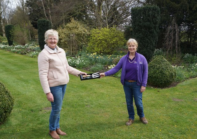 Debbie Hollingworth, right, was presented with the commemorative fork by NGS organiser for Lincolnshire, Helen Boothman EMN-210413-080327001