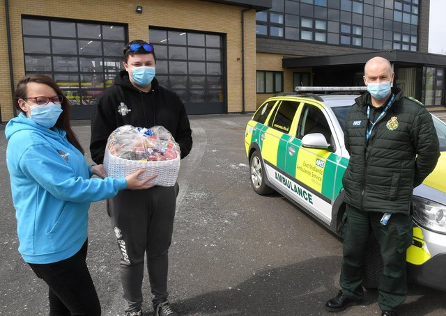 Amanda Taylor and James Maynard of Madmedic Gaming, Sleaford, delivering a hamper to Sleaford Ambulance Station. Receiving the hamper is paramedic, Phil Humberstone. EMN-210419-163708001