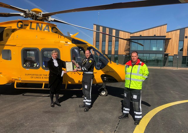 The High Sheriff of Lincolnshire, Michael Scott, presented the award to chief pilot Llewis Ingamells