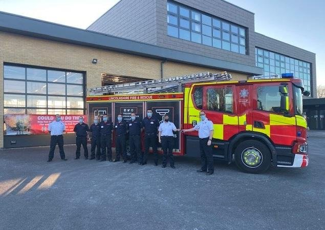 Sleafords part-time 'on-call' firefighting crew saw their new fire appliance arrive on Thursday as part of an ?8m investment in new kit across the county. Pictured are Group Manager Matthew Perrin handing over the keys to Watch Manager Kerry Raynor with some of the on-call crew. EMN-210416-164756001