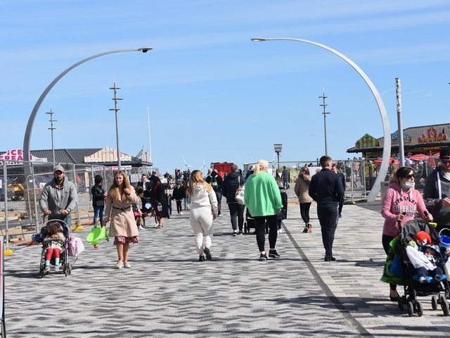 Visitors yesterday on the new pedestrianised walk to the beach in Skegness. Photo: Barry Robinson.