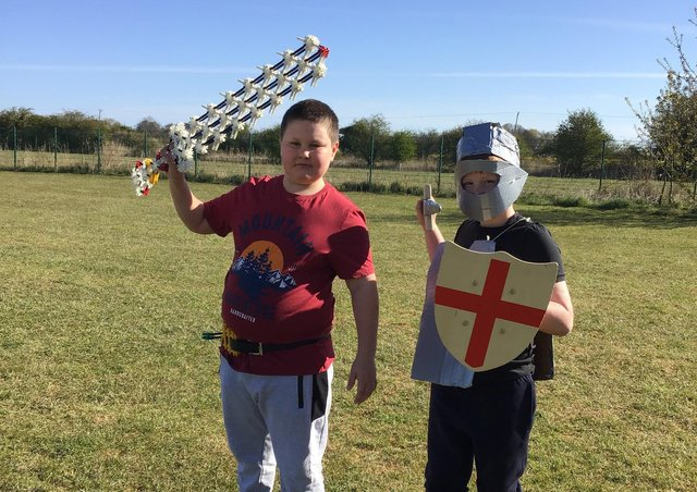 Freddie dressed as St George, and Leon the knight with his homemade sword – made from K'Nex.