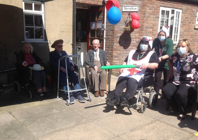 Ready for jousting. Staff and residents at Folkingham's Five Bells care home. EMN-210427-164256001