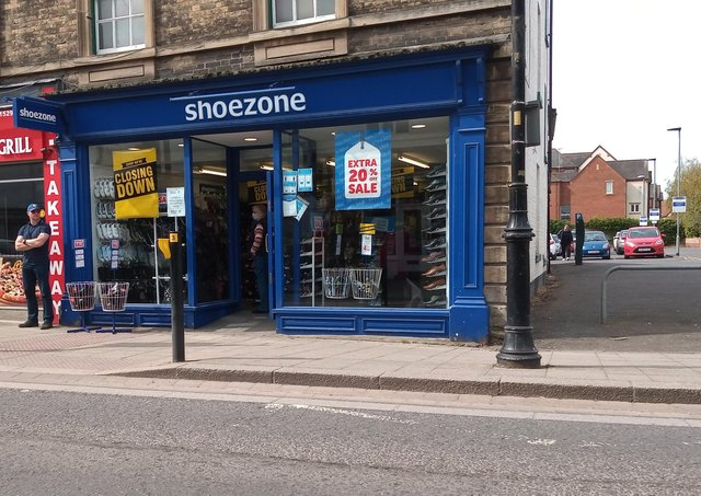 Closing down signs across the windows of the Sleaford branch of Shoe Zone. EMN-210428-164411001