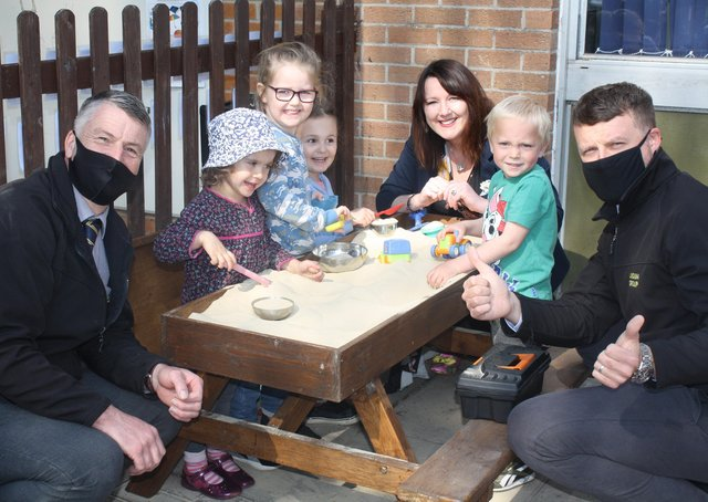 Lindum Group managers and Heckington Pre-School Manager Sue Berry see children enjoying their new sandpit. EMN-210505-173501001