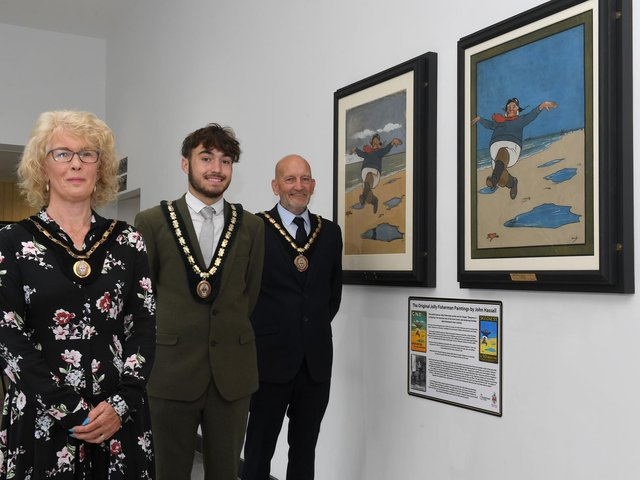 The unveiling of the original paintings of the Jolly Fisherman by Mayor of Skegness Coun John Byford, with Mayoress Jane Byford and Deputy Mayor Coun Billy Brookes.