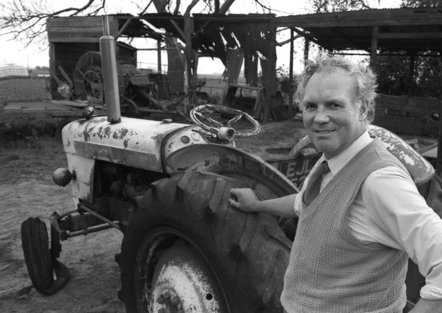 Fishtoft Farmer Roy Bolland and his 'self-drive' tractor pictured near the gutted shed.