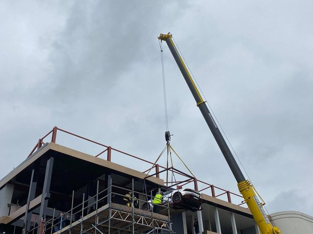 A £350,000 Lamborghini is hoisted into the new Supercar VIP Lounge at the Hive in Skegness.